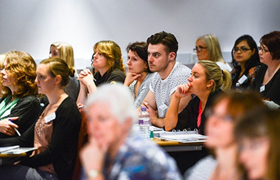Attendees listening to a talk on a training course
