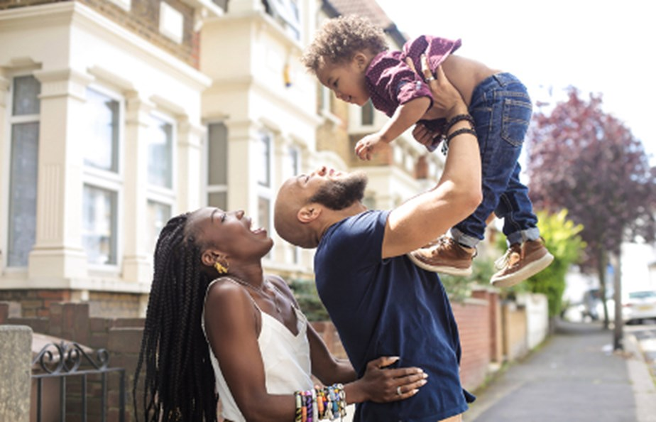 Family Of Three Playing In Street